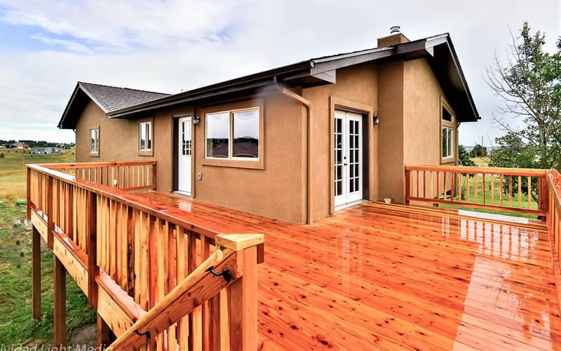 Fire damaged home restoration in Colorado Springs by CMS and FGS - house exterior and deck after